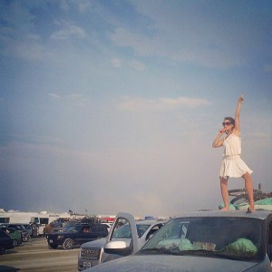 carrot turned microphone on the roof of our car during Burning Man exodus